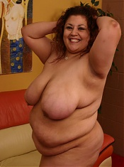 Majestic beauty Reyna in naked for the camera and plays with her queen size milk jugs