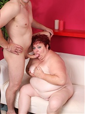Cute redhead plumper Margaret performs excellent oral before she gets sprayed with jizz