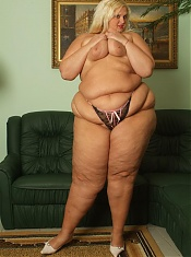 Melinda Shy playfully stripping her clothes and exposing her massive folds of fat