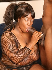 Sensual black camgirl in see though top sucking and riding a dick during a live cam show